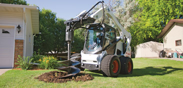 Bobcat Skid Steer with Auger attachment