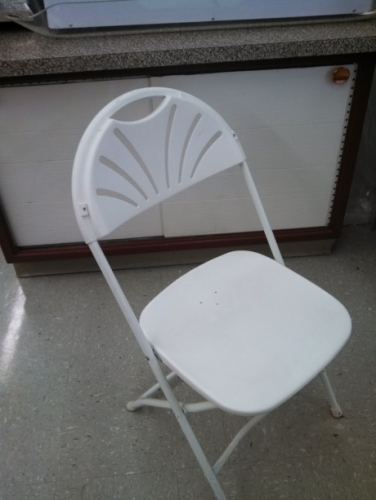 White fanback folding chair