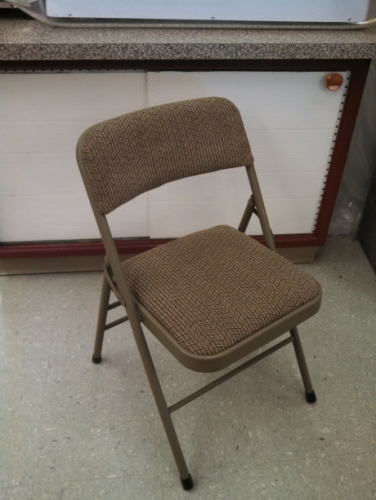 Tan Padded metal folding chair