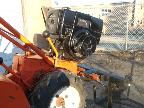 Rear tine tiller, self propelled