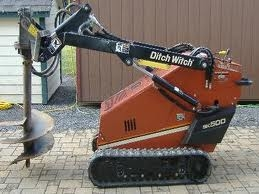 Mini-Skid steer, with post hole auger.