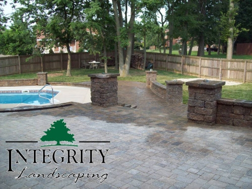 Tiered Paver Patios Lead to Pool