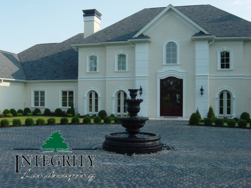 A Grand Fountain as a Driveway Centerpiece